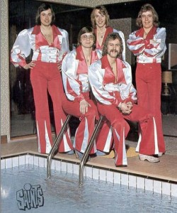 Note the clogs. And strange swimming-pool juxtaposition. I bet they\'re all wearing Speedos